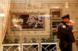 Security officer on a break, in the lobby of the Trump Tower, while President elect Donald Trump is holding meetings on top floors of the building, November 21, 2016, in New York, NY. (Aude Guerrucci / Pool)