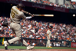 San Diego Padres' Manny Machado (13) lines an RBI single against the San Francisco Giants during the sixth inning of a baseball game, Saturday, Oct. 2, 2021, in San Francisco. (AP Photo/D. Ross Cameron)