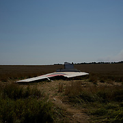 Wreckage of the Malaysia Airlines flight MH17 rests on a field in Grabovo.
