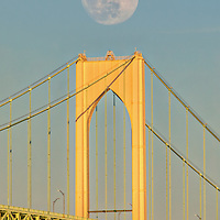 Coastal Rhode Island seascape and full moon photography over the Claiborne Pell Newport Bridge that spans Narragansett Bay connecting the City of Newport on Aquidneck Island and the Town of Jamestown on Conanicut Island. Rhode Island has become an inspiration and is a heaven for macro, seascape, and landscape photography that makes for great wall art. Especially sunrise, sunset and the light of the golden hours paint the sky in beautiful colors and bring out the beauty of the Ocean State as it did during this full moon rise.<br />