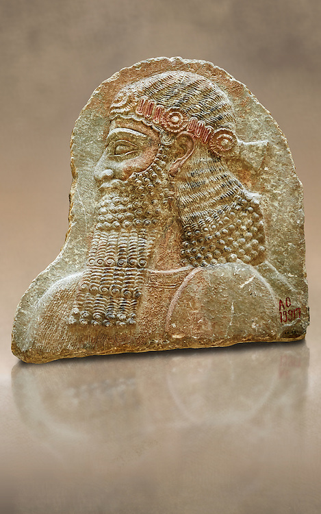 Stone relief sculptured panel of a man. From the facade of the throne room,  Inv AO 19917 from Dur Sharrukin the palace of Assyrian king Sargon II at Khorsabad, 713-706 BC.  Louvre Museum Room 4 , Paris .<br /> <br /> If you prefer to buy from our ALAMY PHOTO LIBRARY  Collection visit : https://www.alamy.com/portfolio/paul-williams-funkystock/ancient-assyria-antiquities.html  Refine search by adding background colour, place, subject, museum etc into the LOWER SEARCH WITHIN GALLERY box to <br /> <br /> Visit our ANCIENT WORLD PHOTO COLLECTIONS for more photos to download or buy as wall art prints https://funkystock.photoshelter.com/gallery-collection/Ancient-World-Art-Antiquities-Historic-Sites-Pictures-Images-of/C00006u26yqSkDOM