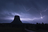 It was a very dark night at Devil's Tower, in between lightning bolts. The lightning was difficult to expose for, since it was infrequent, and usually very bright. This was one of the dimmer bolts. I was standing underneath the back door of my car to stay out of the rain when I took this.