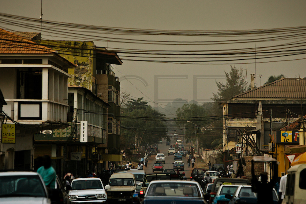 A view of downtown Bissau and the late afternoon traffic in the streets.