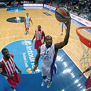 Anadolu Efes's Stephane Lasme (C) and Olympiacos's Matt Lojeski (L), Othello Hunter (2ndL) during their Gloria Cup Basketball Tournament match Anadolu Efes between Olympiacos at Ulker Sports Arena in istanbul Turkey on Tuesday 23 September 2014. Photo by Aykut AKICI/TURKPIX