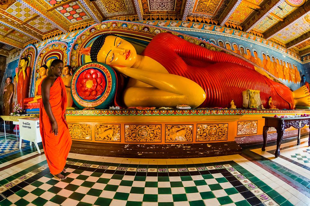 Reclining Buddha, Isurumuniya Temple, Anuradhapura, Sri Lanka. Anuradhapura is one of the ancient capitals of Sri Lanka, famous for its well-preserved ruins of an ancient Sri Lankan civilization.