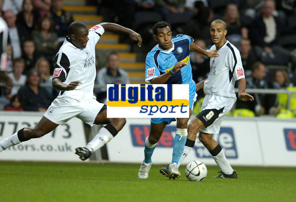 Photo: Adam Davies.<br />Swansea City v Wycombe Wanderers. Carling Cup. 22/08/2006.<br />Wycombe's  kKeviBbesty is tackled by sSwansea'sJermaine Easter watched by Darren Pratley.