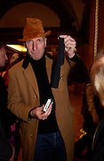 Richard Strange with his camera in a sock, 1st Anniversary party at the Saatchi gallery for the private view of Young Blood. 23 March 2004. ONE TIME USE ONLY - DO NOT ARCHIVE  © Copyright Photograph by Dafydd Jones 66 Stockwell Park Rd. London SW9 0DA Tel 020 7733 0108 www.dafjones.com