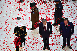 The floor the Lloyd's building is covered in poppies after they were dropped through the atrium during the Lloyd's of London Armistice commemoration service.