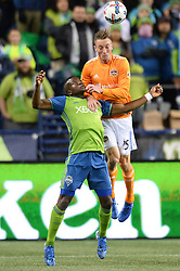 November 30, 2017 - Seattle, Washington, U.S - Soccer 2017: DYLAN REMICK (15) and NOUHOU (5) battle for the ball as the Houston Dynamo play the Seattle Sounders in the 2nd leg of the MLS Western Conference Finals match at Century Link Field in Seattle, WA. (Credit Image: © Jeff Halstead via ZUMA Wire)