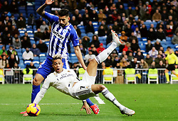 MADRID, Feb. 4, 2019  Real Madrid's Mariano Diaz Mejia (R) vies with Alaves' Guillermo Maripan during a Spanish La Liga match between Real Madrid and Alaves in Madrid, Spain, on Feb. 3, 2019. Real Madrid won 3-0. (Credit Image: © Edward F. Peters/Xinhua via ZUMA Wire)