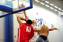 Bristol Academy Flyers' Enrique Garcia shoots before he falls out of bounds - Photo mandatory by-line: Dougie Allward/JMP - Tel: Mobile: 07966 386802 23/03/2013 - SPORT - Basketball - WISE Basketball Arena - SGS College - Bristol -  Bristol Academy Flyers V Essex Leopards