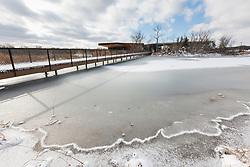 Trinity River Audubon Center building after winter snow, Dallas, Texas, USA.