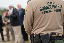 January 10, 2019 - McAllen, Texas, U.S. - U.S. Customs and Border Protection officers listen to President Donald J. Trump addressing his remarks during his visit to an overlook along the Rio Grande Thursday, January 10, 2019, near the U.S. Border Patrol McAllen Station in McAllen, Texas. (Credit Image: © White House/ZUMA Wire/ZUMAPRESS.com)