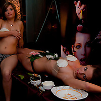 Girls pose after their work is done with sushi being served on their naked bodies follwing the japanese traditions in a club in downtown Budapest, Hungary on September 23, 2011. ATTILA VOLGYI