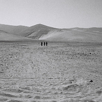 1. When was this photo taken?<br /> <br /> 2012<br /> <br /> 2. Where was this photo taken?<br /> <br /> Chilean Desert<br /> <br /> 3. Who took this photo?<br /> <br /> I did<br /> <br /> 4. What are we looking at here?<br /> <br /> Three mysterious people wandering the vast and deserted northern Chilean landscape.<br /> <br /> 5. How does this old photo make you feel?<br /> <br /> The feeling you get often in the Chilean country side of being very far away and extracted from the rest of the world.<br /> <br /> 6. Is this what you expected to see?<br /> <br /> I had no idea what was on those rolls<br /> <br /> 7. What kind of memories does this photo bring back?<br /> <br /> Good ones of traveling on the open road<br /> <br /> 8. How do you think others will respond to this photo?<br /> <br /> Thats up to them, hard to say... Everyone reacts differently.