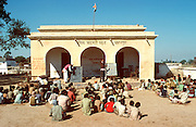 INDIA, NORTHERN Primary rural school with boys studying outdoors