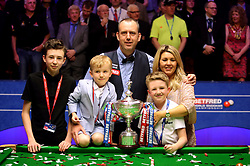Mark Williams and family with the trophy after winning the 2018 Betfred World Championship at The Crucible, Sheffield.