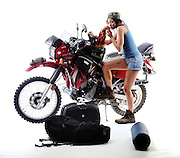 "Gary Miller's Kawasaki KLR motorcycle shot in studio for article on ""The Ultimate KLR"" for Adventure Rider Magazine.  Taylor Reazin is model."