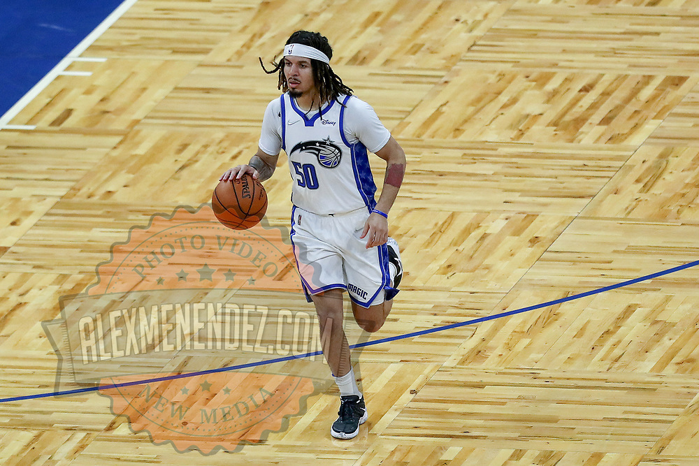 ORLANDO, FL - APRIL 12: Cole Anthony #50 of the Orlando Magic dribbles the ball against the San Antonio Spurs at Amway Center on April 12, 2021 in Orlando, Florida. NOTE TO USER: User expressly acknowledges and agrees that, by downloading and or using this photograph, User is consenting to the terms and conditions of the Getty Images License Agreement. (Photo by Alex Menendez/Getty Images)*** Local Caption *** Cole Anthony