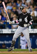 Chicago White Sox's Nick Swisher reacts as he is called out on strikes to end the first inning against the Seattle Mariners in Seattle. (AP Photo/John Froschauer)