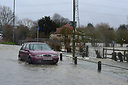© Licensed to London News Pictures. 11/02/2014. Shepperton and Chertsey, UK. An abandoned car on Chertsey Bridge Road.  Flooding in SHEPPERTON AND CHERTSEY in Surrey today 11th February 2014 after the River Thames burst its banks. The Environment Agency has issued 14 Severe Flood Warnings alone the Thames. Photo credit : Stephen Simpson/LNP