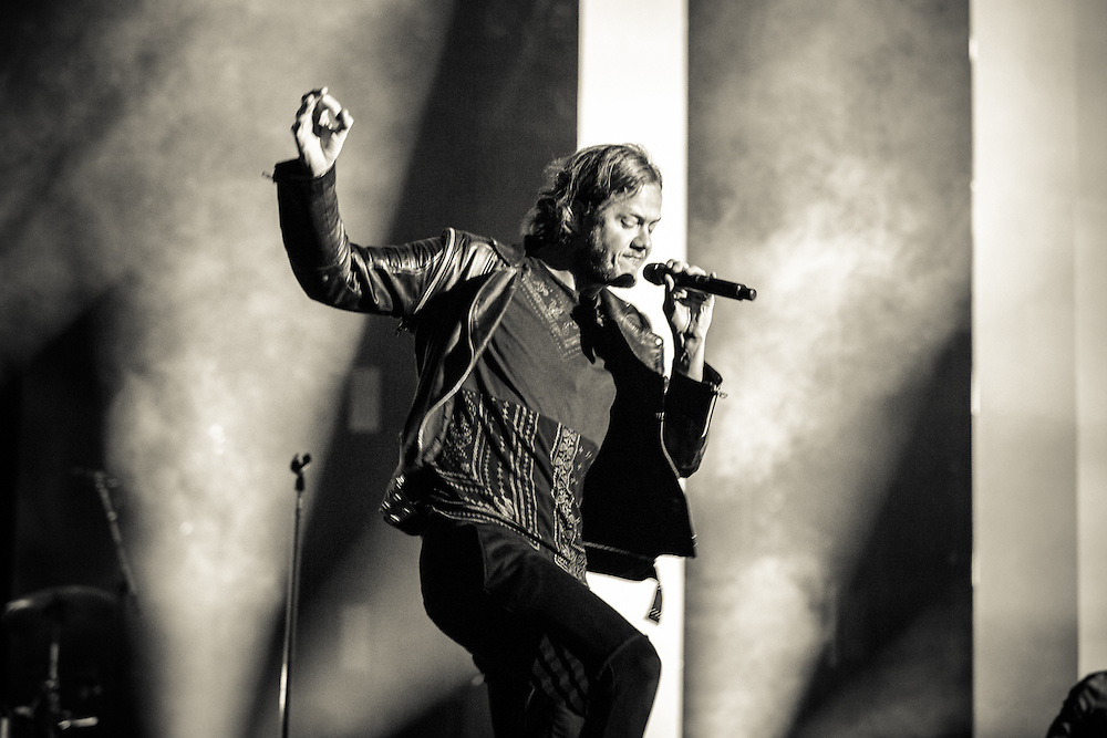 Dan Reynolds, lead vocalist of the American rock band IMAGINE DRAGONS playing live at the Koenig-Pilsener-Arena in Oberhausen, the first European show  of the Smoke + Mirrors Tour 2015.<br /> © IRIS EDINGER   Photography