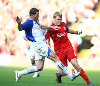 Fotball<br /> England <br /> Foto: Propaganda/Digitalsport<br /> NORWAY ONLY<br /> <br /> LIVERPOOL, ENGLAND - SATURDAY, OCTOBER 14th , 2006: Liverpool's John Arne Riise and Blackburn Rovers' Brett Emerton during the Premiership match at Anfield.