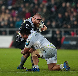 Ospreys' Dimitri Arhip is tackled by Saracens' Mako Vunipola<br /> <br /> Photographer Simon King/Replay Images<br /> <br /> European Rugby Champions Cup Round 5 - Ospreys v Saracens - Saturday 13th January 2018 - Liberty Stadium - Swansea<br /> <br /> World Copyright © Replay Images . All rights reserved. info@replayimages.co.uk - http://replayimages.co.uk