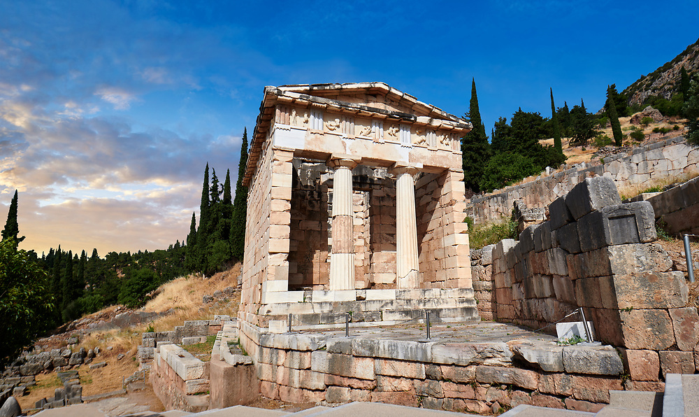 The Treasury of Athens on the processional way of Delphi, Delphi archaeological site, Delphi, Greece .<br /> <br /> If you prefer to buy from our ALAMY PHOTO LIBRARY  Collection visit : https://www.alamy.com/portfolio/paul-williams-funkystock/delphi-site-greece.html  to refine search type subject etc into the LOWER SEARCH WITHIN GALLERY.<br /> <br /> Visit our ANCIENT GREEKS PHOTO COLLECTIONS for more photos to download or buy as wall art prints https://funkystock.photoshelter.com/gallery-collection/Ancient-Greeks-Art-Artefacts-Antiquities-Historic-Sites/C00004CnMmq_Xllw
