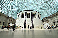 Visitors enjoy the tranquility of the British Museum under Norman Foster's glass roof