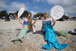 © Licensed to London News Pictures.  12/06/2021. Falmouth, UK. Members of the public take part in protest organised by Surface Against Sewage on the beach in Falmouth, Cornwall as the second day of the G7 summit continues. Photo credit: Marcin Nowak/LNP