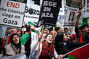 London, UK. Saturday 17th November 2012. Female demonstrator shouts. Demonstration against Israeli attacks on Gaza. Hundreds of Palestinians and Pro-Palestinians gathered to protest to gain freedom for Palestine and against Israel's recent shelling.