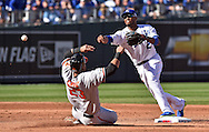 Oct 15, 2014; Kansas City, MO, USA; Kansas City Royals shortstop Alcides Escobar (2) turns a double play over Baltimore Orioles designated hitter Nelson Cruz (23) during the second inning in game four of the 2014 ALCS playoff baseball game at Kauffman Stadium. Mandatory Credit: Peter G. Aiken-USA TODAY Sports