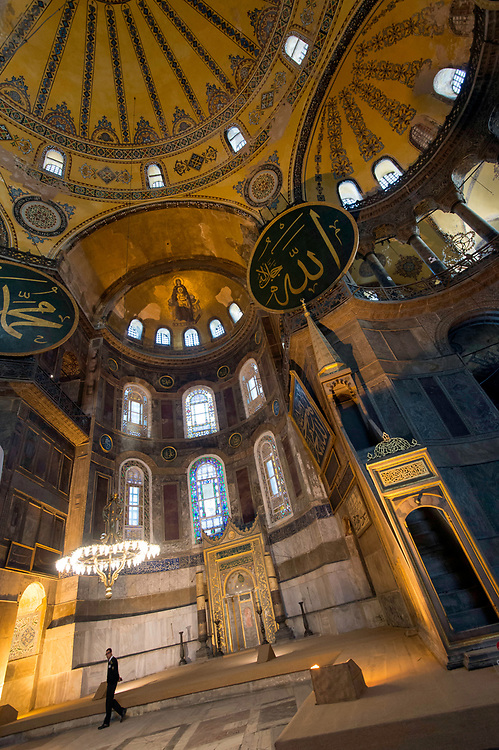 """Interior of Haghia Sophia.Aya Sofia.Hagia Sophia (from the Greek: Ἁγία Σοφία, """"Holy Wisdom""""; Latin: Sancta Sophia or Sancta Sapientia; Turkish: Ayasofya) is a former Greek Orthodox patriarchal basilica (church), later an imperial mosque, and now a museum (Ayasofya Müzesi) in Istanbul, Turkey. From the date of its construction in 537 until 1453, it served as an Eastern Orthodox cathedral and seat of the Patriarchate of Constantinople,except between 1204 and 1261, when it was converted to a Roman Catholic cathedral under the Latin Empire. The building was a mosque from 29 May 1453 until 1931. It was then secularized and opened as a museum on 1 February 1935. The Hagia Sophia is part of the UNESCO World Heritage site in Istanbul. For almost a millennium after its construction, it was the largest cathedral in all of Christendom. It served as a center of religious, political, and artistic life for the Byzantine world and has provided us with many useful scholarly insights into the period. It was also an important site of Muslim worship after Sultan Mehmed II conquered Constantinople in 1453 and designated the structure a mosque. It would remain a mosque until being converted into a museum in the 1930s."""
