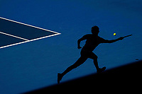 Russian ace Alexander Zverev chases hard in the deep shadows of Rod Laver Arena on day ten of the Australian Open tennis tournament in Melbourne, January 29, 2020.
