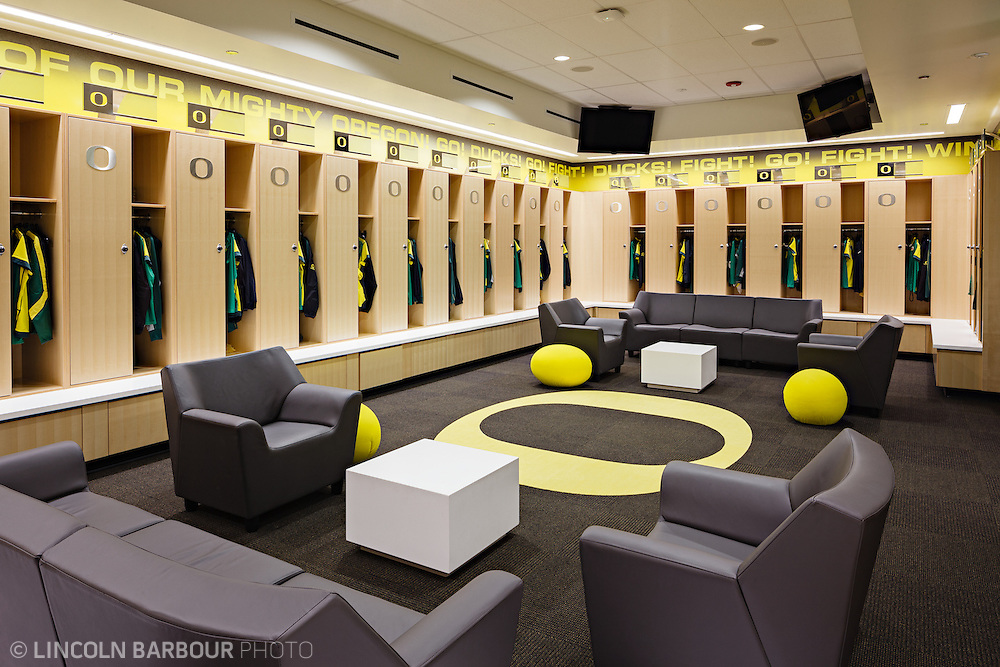 Architectural photo of University of Oregon's Women's Soccer & Lacrosse Stadium. Designed by DLR Group. The home team's locker room is adorned with some nice chairs and couches.