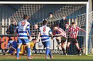 The goalmouth scramble during the FA Trophy match between Oxford City and Cheltenham Town at Court Place Farm, Oxford, United Kingdom on 16 January 2016. Photo by Antony Thompson.