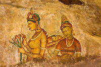 Sigiriya Frescos - Sigiriya is an ancient rock fortress and palace ruin renowned for its ancient fresco paintings.  Ancient fresco and graffiti on the Mirror Wall, there were once some five hundred frescoes covering the western surface of Sigiriya Rock at one time visible from all vantage points of the complex. The frescos resemble Ajanta Caves of India.