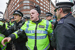 "© Licensed to London News Pictures . 20/10/2012 . London , UK . Police help an injured colleague following a scuffle with Black Bloc protesters . The TUC march in London against austerity and cuts , under the banner "" March for a future that works "" . Photo credit : Joel Goodman/LNP"