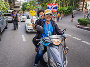 29 NOVEMBER 2013 - BANGKOK, THAILAND: Anti-government protestors motorcade down Sukhumvit Road in Bangkok towards the US Embassy. Several thousand Thai anti-government protestors marched on the US Embassy in Bangkok. They blew whistles and asked the US to honor their efforts to unseat the elected government of Yingluck Shinawatra. The anti-government protestors marched through several parts of Bangkok Friday paralyzing traffic but no clashes were reported, even after a group protestors tried to occupy Army headquarters.         PHOTO BY JACK KURTZ