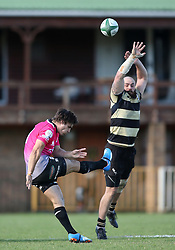 Emile Temperman of the Pumas kicks an up and under as Shaun Adendorff of Boland attempts to make the block during the Currie Cup premier division match between the Boland Cavaliers and The Pumas held at Boland Stadium, Wellington, South Africa on the 2nd September 2016<br /> <br /> Photo by:   Shaun Roy/ Real Time Images