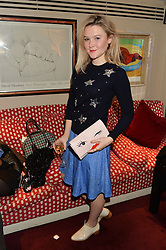 AMBER ATHERTON at a dinner hosted by fashion label Kate Spade NY held at George, 87-88 Mount Street, London on 19th November 2014.