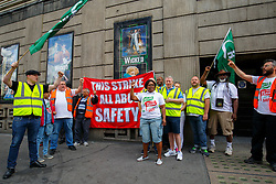 © Licensed to London News Pictures. 08/08/2016. London, UK. RMT union members of Southern Train service protest at a picket line outside Victoria Station in London, as hundreds of thousands of rail passengers face a week of travel chaos because of a five-day strike in an escalating dispute over the role of conductors between Southern Rail and the RMT Union. Photo credit: Tolga Akmen/LNP