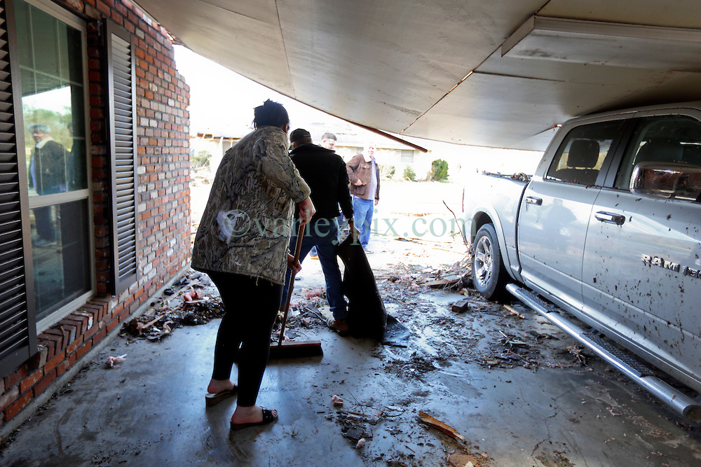 24 February 2016. Schexnaydre St, Convent, Louisiana.<br /> Scenes of devastation following a deadly EF2 tornado touchdown. 2 confirmed dead. Survivors clear debris from their smashed home.<br /> Photo©; Charlie Varley/varleypix.com