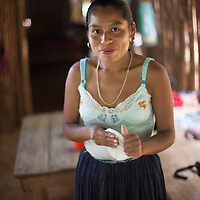 Matilde, a young Q'eqchi woman making tortillas. This is a routine at least once a day for every household.