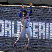 New York Mets center fielder Yoenis Cespedes (52) catches ball hit by Kansas City Royals right fielder Alex Rios (15) in the sixth inning during Wednesday's World Series baseball game on October 28, 2015 at at the Kauffman Stadium in Kansas City, Mo.