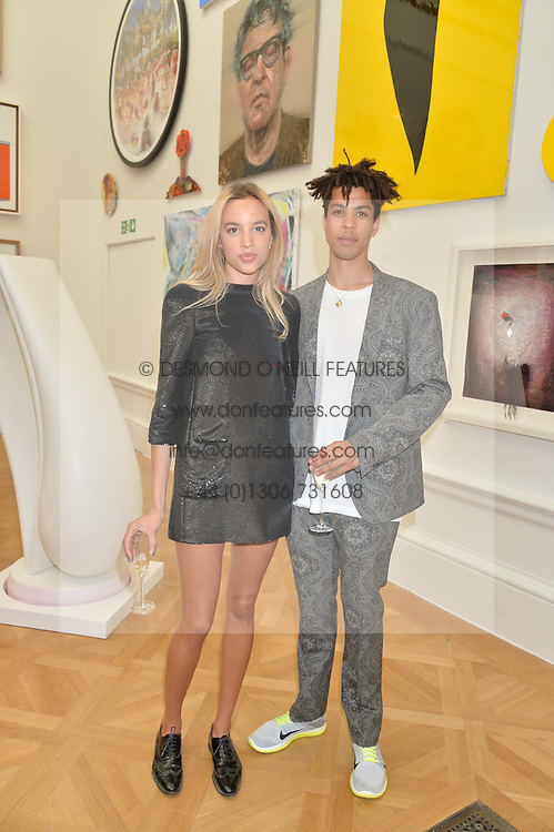 PHOEBE COLLINGS JAMES and SEAN FRANK at the annual Royal Academy of Art Summer Party held at Burlington House, Piccadilly, London on 4th June 2014.