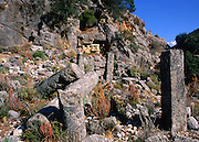 Ruined buildings and rock tomb, Lycian city of Pinara, Turkey
