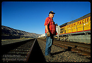Conductor Jim Collins does roll-by inspection of a Union Pacific train in the Columbia Rvr Gorge. Oregon