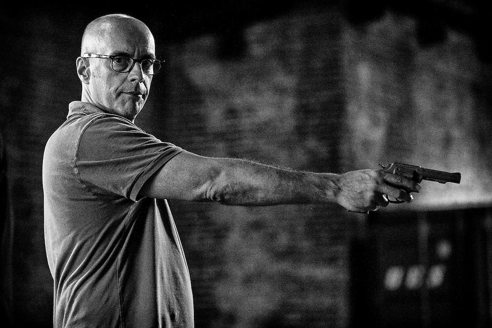 """Director Nick Gomez demonstrating a scene for actor John Corbett on the set of TNT's """"Ricochet"""" in New Orleans, LA."""